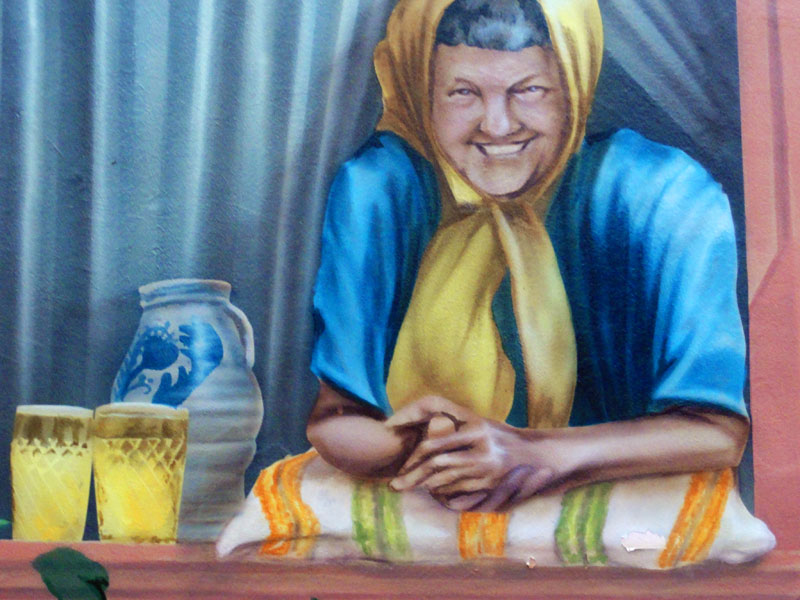 Graffiti-Hauswand mit Frau Rauscher und dem blauen Bock