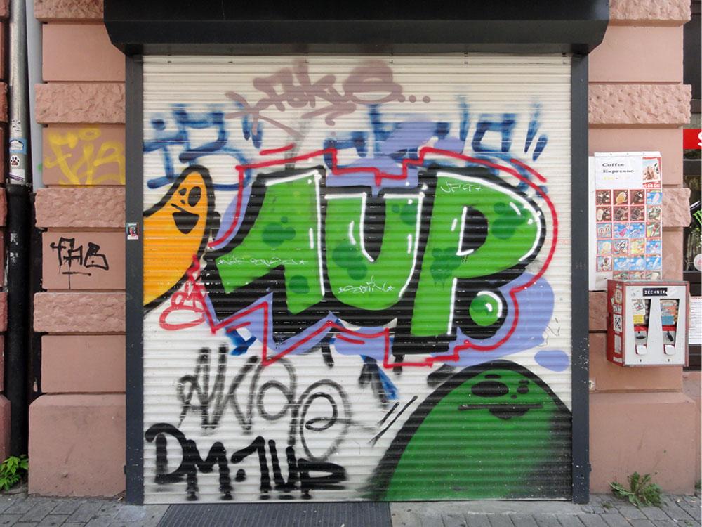 Shutter Art and garage Door Graffiti by 1UP and SPOT