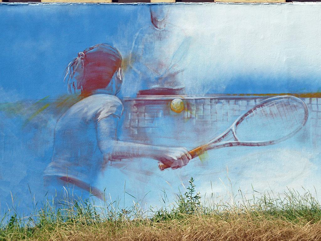 Graffitiwand mit Sportlern von Guido Zimmermann in Fechenheim
