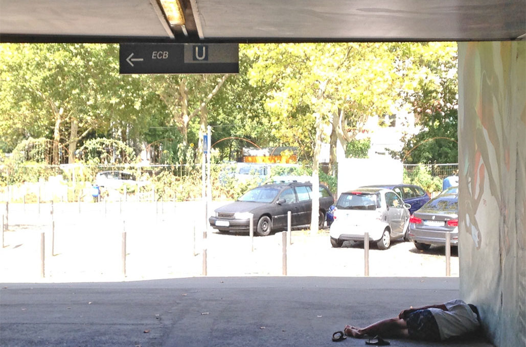 Homeless people at metro station nearby ECB