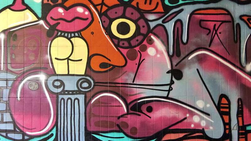 Graffiti an der Blütentunnel-Wall in Darmstadt-Arheilgen