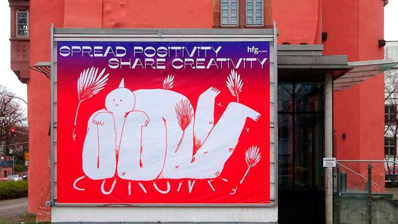 Plakat SPREAD POSITIVITY SHARE CREATIVITY bei der HfG in Offenbach