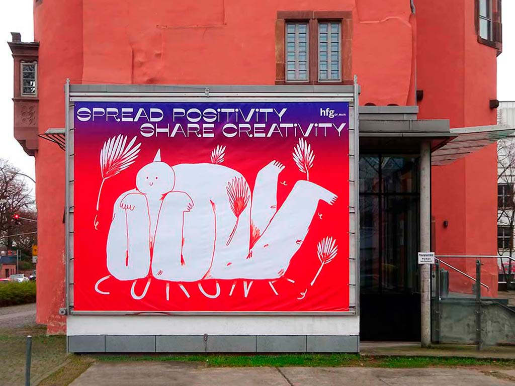 Plakat SPREAD POSITIVITY SHARE CREATIVITY bei der HfG in Offenbach