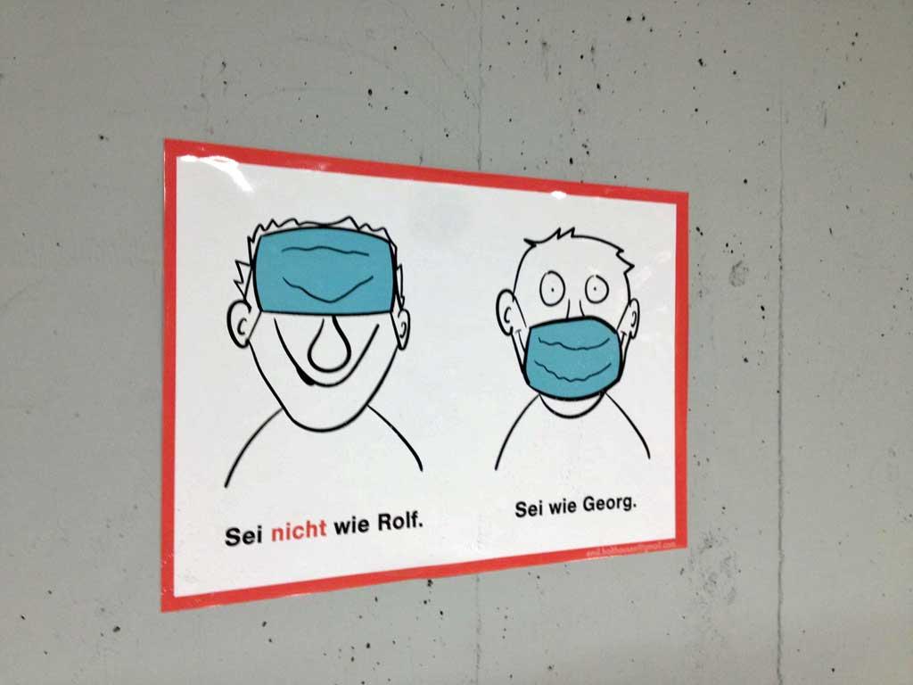 Corona-Hinweis - Sei nicht wie Rolf. Sei wie Georg.