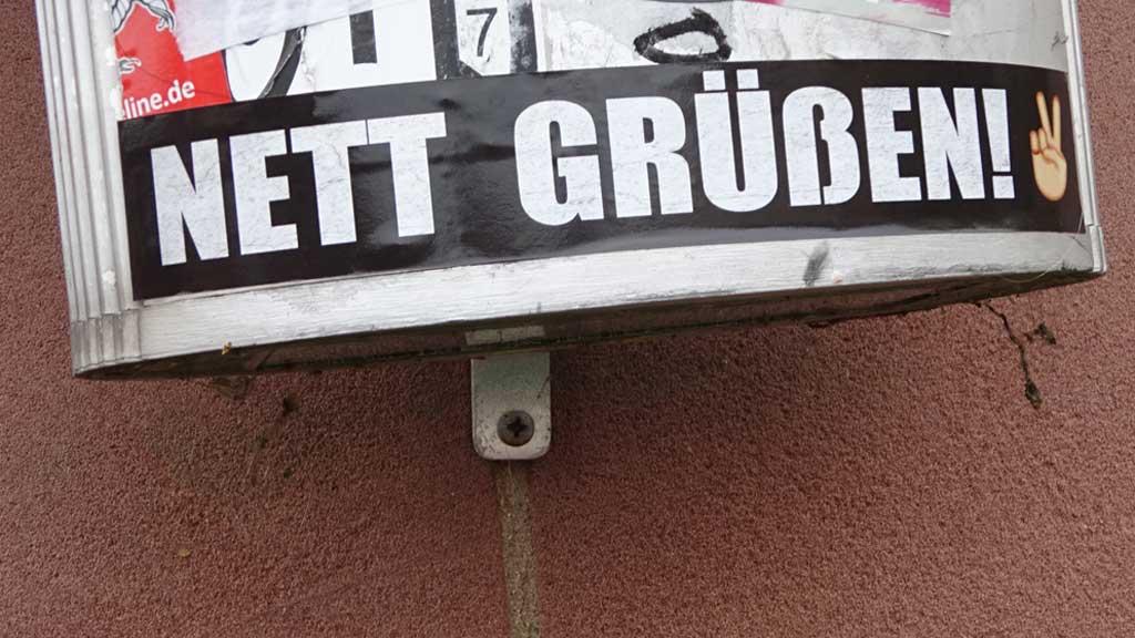 "Aufkleber mit ""Nett grüßen!"""