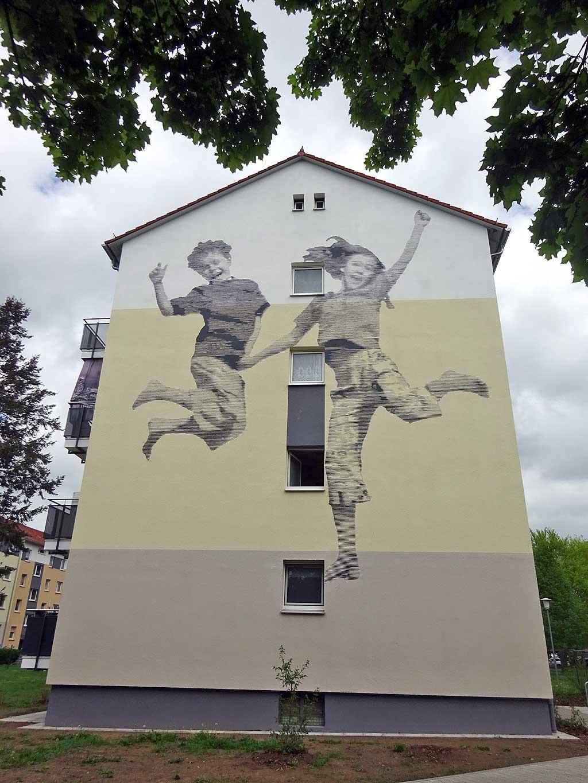 Streetart mit Kinder-Motive in der Birsteiner Straße