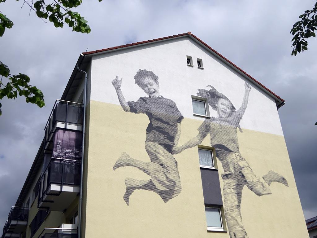 Wandbild mit Kindern in der Birsteiner Straße in Frankfurt