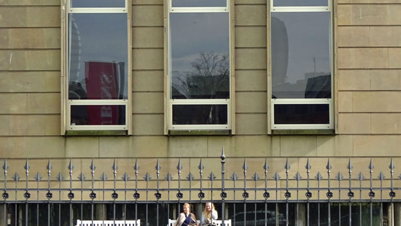 Young women in front of the Staedel Museum in Frankfurt Germany